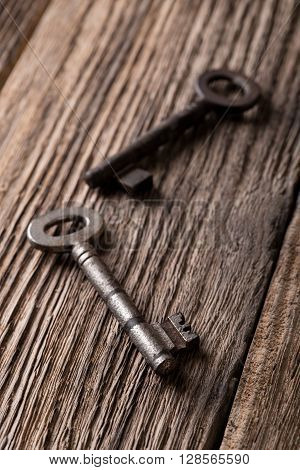 Two Old Keys On Old Worn Wooden Board