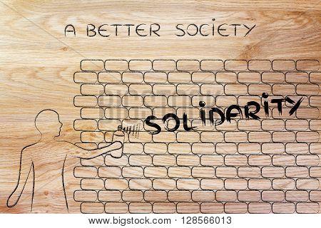 Man Writing Solidarity As Wall Graffiti, A Better Society