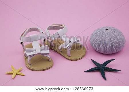 portrait of a pair of baby girl sandals