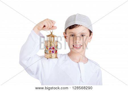 Happy Ramadan - Young boy smiling and holding Ramadan lantern