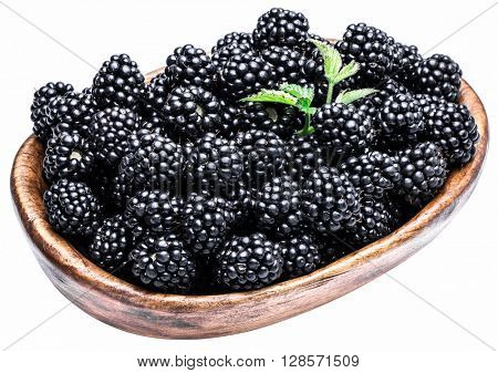 Blackberries in the wooden bowl isolated on a white background.