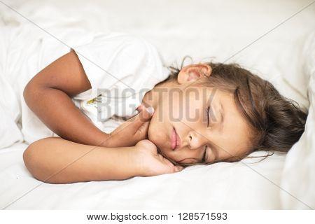 Sleeping kid girl in the bed.