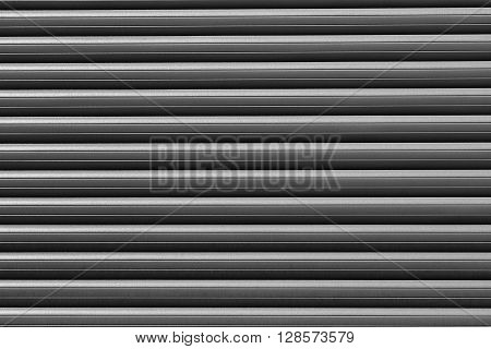 Parallel plates of a roller shutter as a background.