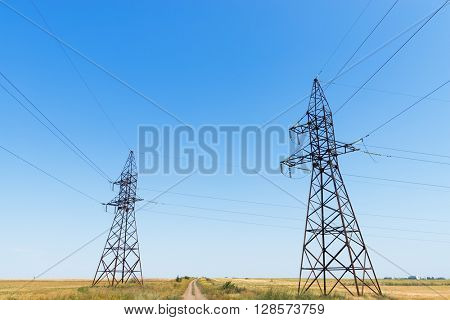 two electric tower under blue sky