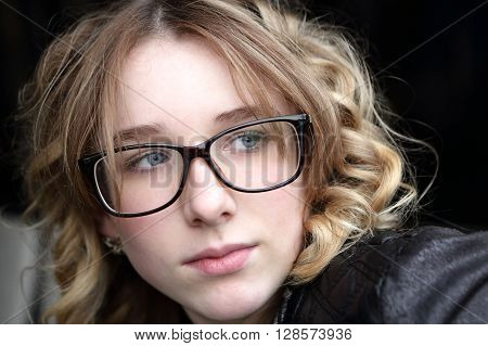 Serious Teen In Glasses