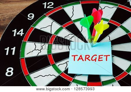Darts And Bull Eyes With Word Target On Paper