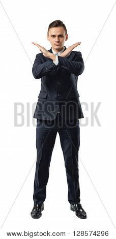 Serious businessman making X sign with his arms to stop doing something. Signs symbols. Body language. Prohibitions and restrictions. Front view. Office clothes. Dress code.