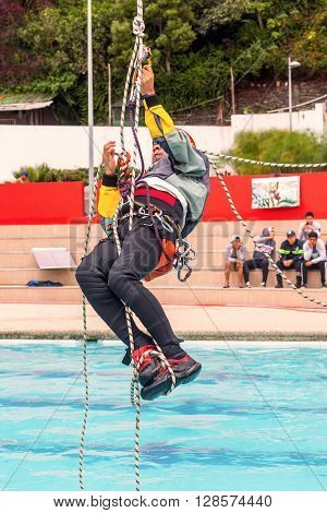 Banos Ecuador - 23 May, 2015: Exercise Climbing Rescue Demonstration Of A Sports Guide In A Public Competition In Banos On May 23, 2015