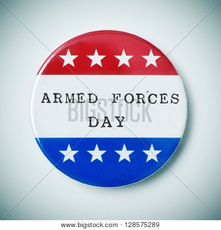 closeup of a pin button with the text armed forces day and the colors and stars of the flag of the United States, with a slight vignette added