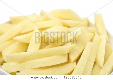 closeup of a bowl full of sliced potatoes ready to fry