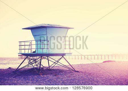 Vintage Toned Picture Of A Lifeguard Tower At Sunset.