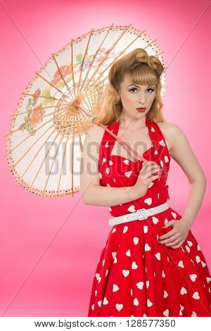 Pin up girl with parasol wearing vintatge clothing