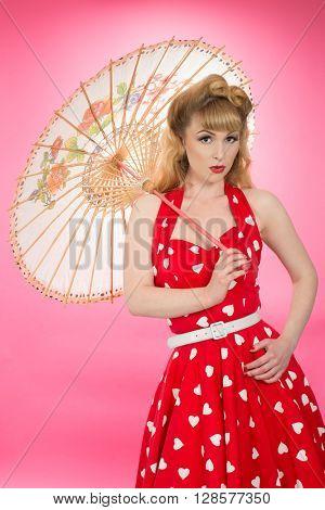 Pin up girl with parasol wearing vintatge clothing