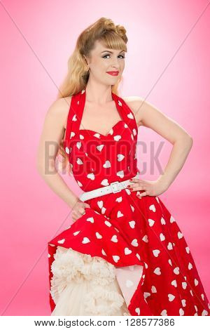 Pin up girl wearing vintage 1950's dress with frilly petticoat
