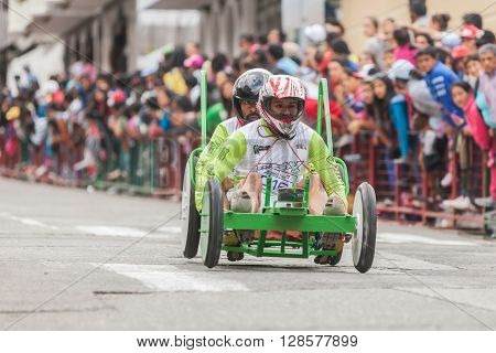 BANOS DE AGUA SANTA - 11 DECEMBER 2015: Unidentified Drivers On A Wooden Cart Racing In A Public Competition In South America BANOS DE AGUA SANTA on DECEMBER 11 2015