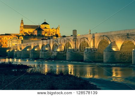 Night view of Mezquita-Catedral and Puente Romano - Mosque-Cathedral and the Roman Bridge in Cordoba Andalusia Spain