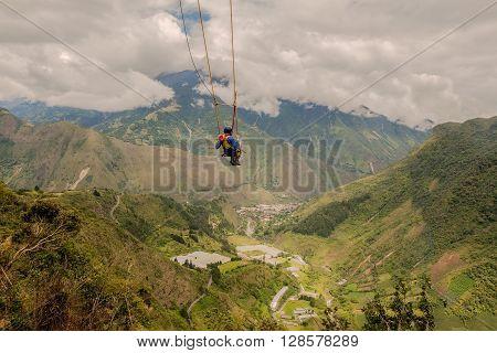 Silhouette Of Young Man On A Swing called Flight of the Condor Banos de Agua Santa Ecuador