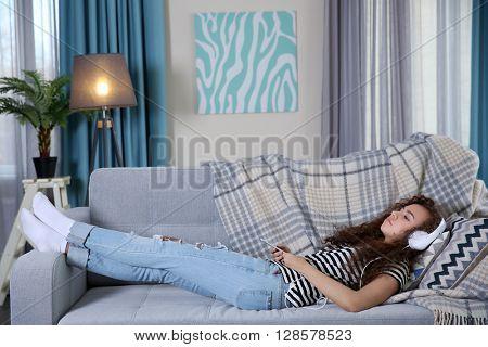 Beautiful girl sleeping on couch