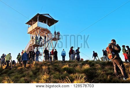 POON HILL, NEPAL - OCTOBER 12, 2008: Tourists meet the sunrise at top of Poon Hill in Himalayas, Nepal