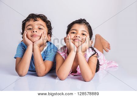 A picture of indian young siblings, asian little siblings closeup
