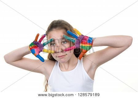 Portrait of a cute cheerful girl showing her hands painted in bright colors isolated over white