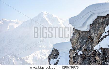 Winter mountain top with big snow cap as backgorund