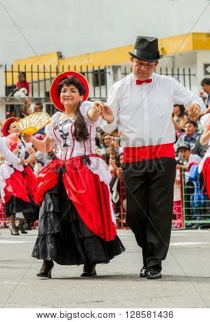 Banos De Agua Santa - 29 November, 2014 : Latin Adult Couple Dressed Formal Dancing On The Streets Of Banos De Agua Santa In Banos De Agua Santa On November 29, 2014