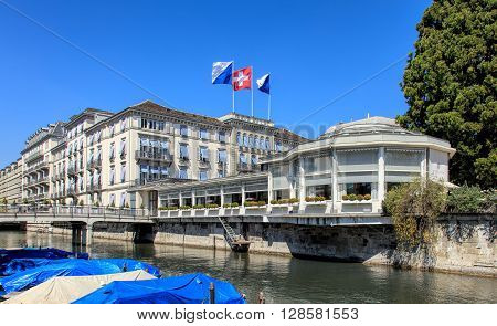 Zurich, Switzerland - 20 April, 2016: the Baur au Lac Hotel building decorated with flags of Zurich and Switzerland view from Am Schanzengraben embankment. The Baur au Lac Hotel is a luxury hotel in Zurich Switzerland founded in 1844 by Johannes Baur.