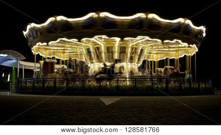illuminated retro vintage carousel at night