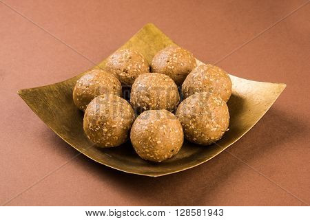 The indian sesame sweet or tilgul laddu, made up of jaggery and sesame seeds, hand made, round, indian sweet prepared in Makar Sankranti festival,
