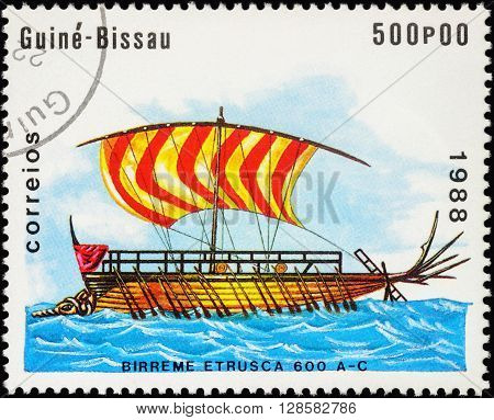 MOSCOW RUSSIA - MAY 01 2016: A stamp printed in Guinea-Bissau shows image of ancient war ship - Bireme Etrusca series