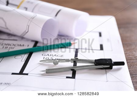 Construction drawings on wooden table closeup