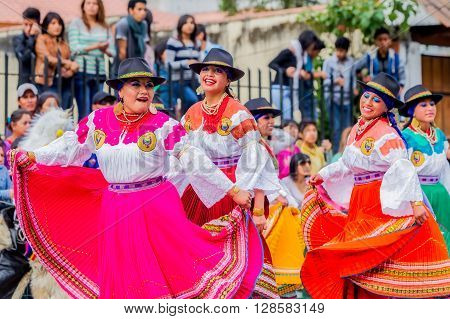 Banos De Agua Santa - 29 November, 2014: Group Of Happy Adult Indigenous Women Dancing On City Streets Of Banos De Agua Santa South America In Banos De Agua Santa On November 29, 2014