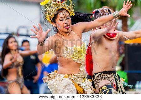 Banos De Agua Santa - 29 November, 2014 : Group Of Youth Huaorani Dancing On City Streets Of Banos De Agua Santa South America In Banos De Agua Santa On November 29, 2014