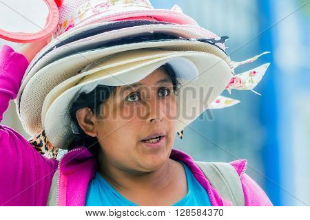 Banos De Agua Santa - 29 November 2014: Portrait Of Hat Seller Woman On The Street Of South America In Banos De Agua Santa On November 29 2014