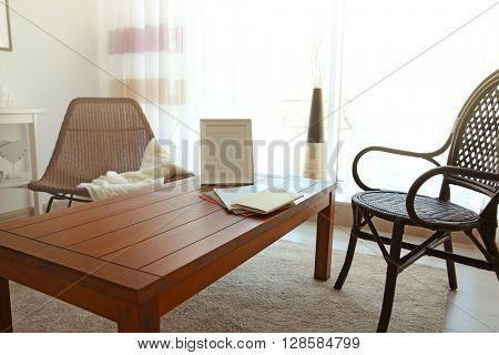 Modern living room interior. Chairs beside wooden table.