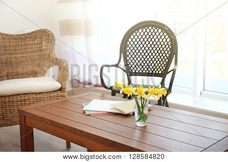 Modern living room interior.Yellow bouquet on daffodils on a table