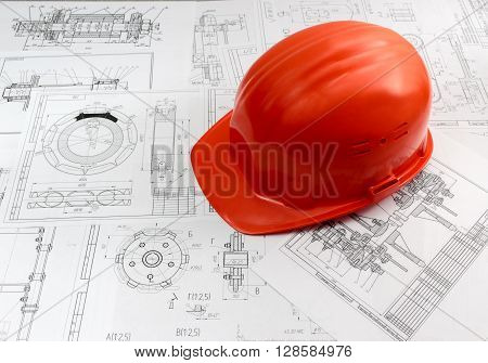 Orange protective helmet factory for engineering drawings. A must-have Accessory or attribute production engineer.