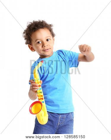 Little boy playing  with musical toy, isolated on white