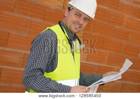 Construction Man On The Job Site Looking At The Camera
