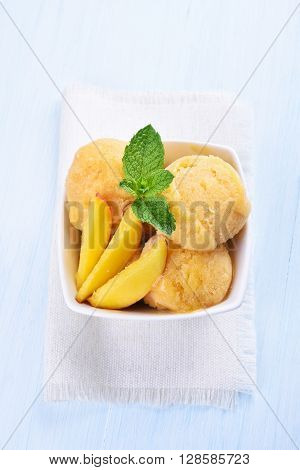 Peach ice cream with slices top view