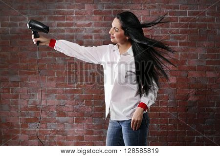 Hairdresser with hairdryer