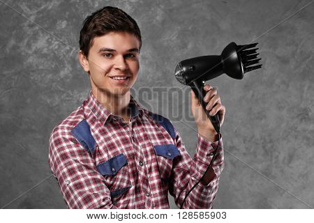 Handsome man  hairdryer
