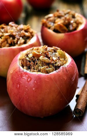 Baked apples stuffed with granola close up