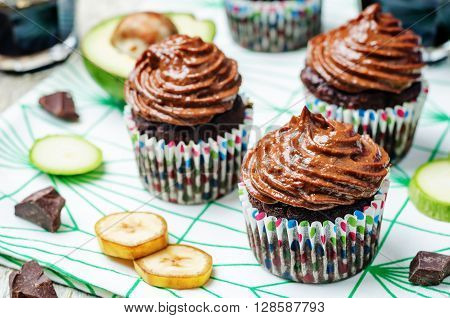 Chocolate zucchini banana cupcakes with chocolate avocado banana peanut butter cream frosting.