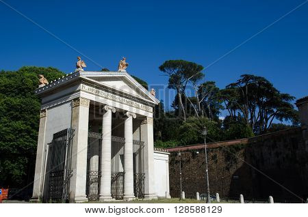 ROME, ITALY - APRIL 25 2016: Monument by the gate at the street Viale Giorgio Washington at the entrance to the park Villa Borghese in Rome Italy