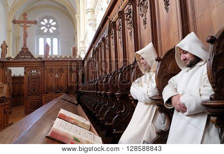 PLETERJE, SLOVENIA - NOVEMBER 06: Carthusians Monks praying in church in the Carthusian monastery in Pleterje, Slovenia on November 06, 2015.