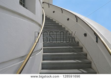 LOS ANGELES - MAY 3: Beautiful outdoor white spiral staircase with bronze railings that leads up to the top of the Griffith Observatory telescope.