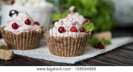 Homemade dessert from cottage cheese cream biscuit and berries