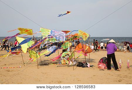 Thanh Hoa, Vietnam - May 2, 2016: Vietnamese vendor selling made in China toys and kite on the beach of Tinh Gia district.